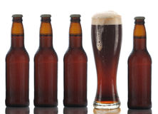 Four Brown Beer Bottles and Full Glass Royalty Free Stock Photography