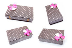 Four brown box with gifts and pink bow Stock Photos