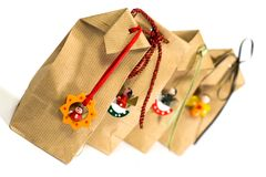 Four brown gift bags Royalty Free Stock Images