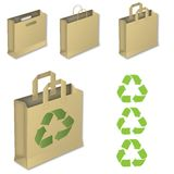 Four brown paper bags with recycle symbol. Stock Photo
