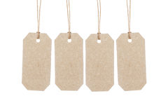 Four brown tags hanging on ropes Royalty Free Stock Photo