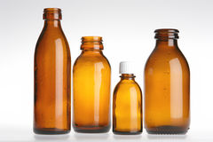 Four Brown Vials Stock Photography