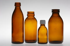Four Brown Vials Stock Images