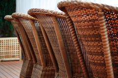 Four brown woden rattan armchairs Stock Photography