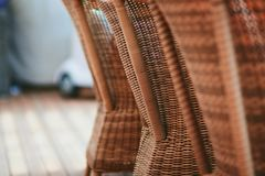 Four brown wooden rattan armchairs Royalty Free Stock Photos