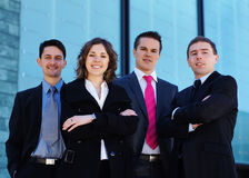 Four brunette business persons in formal clothes Royalty Free Stock Photo