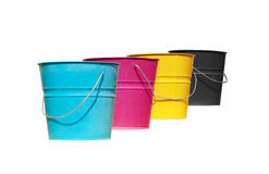 Four buckets of different colors. Cyan, magenta, yellow and black stock images