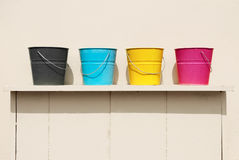 Four buckets of different colors. Cyan, magenta, yellow and black royalty free stock photography