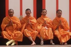Four Buddhist monks meditating, Stock Photo