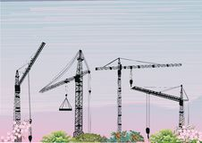 Four building cranes at sunset Stock Images