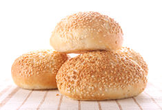 Four buns with sesame seeds Royalty Free Stock Images