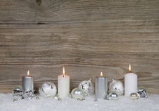 Four burning advent candles on brown wooden background for chris Royalty Free Stock Photo