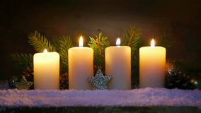 Four burning advent candles and Christmas decoration. stock video footage