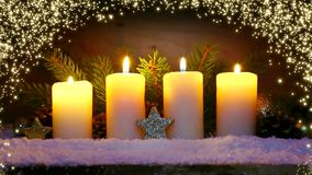 Four burning advent candles and luminous lights. stock video footage