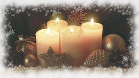 Four burning Advent candles and snow frame. stock video footage