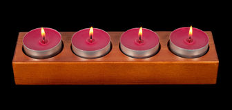 Four burning candles Royalty Free Stock Photos