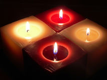 Four burning candles, atmospheric christmas decoration.  Royalty Free Stock Photography