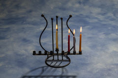 Four burning Hanukkah candles in Menorah Stock Images