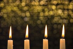 Four burning candles on the fourth advent stock photography