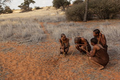 Four bushmen. In kalahari desert in Namibia, they are the indigenous people of Southern Africa Royalty Free Stock Photo