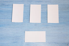 Four business cards are in a row Royalty Free Stock Photos
