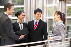 Four Business Colleagues Having Discussion Stock Image