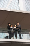 Four Business Colleagues Outside Chatting Royalty Free Stock Image