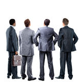 Four business mans from the back. Looking at something over a white background Royalty Free Stock Photography