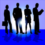 Four business people. An image showing four business people, two men and two women, standing in a line on a stage with their shadows and a blue background with Stock Images