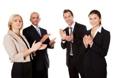 Four business people applauding. Isolated on white Stock Photography