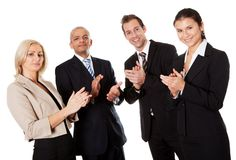 Four business people applauding. Isolated on white Royalty Free Stock Image