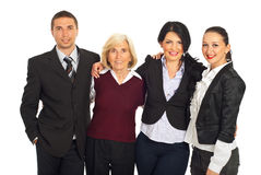Four business people huddling in a row Royalty Free Stock Photos