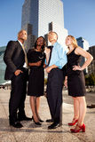 Four Business People Looking Upwards Stock Photo