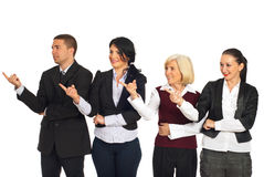 Four business people pointing in left part Royalty Free Stock Photos