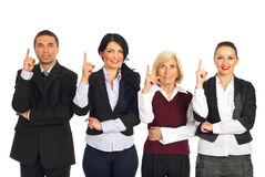 Four business people pointing up Royalty Free Stock Images