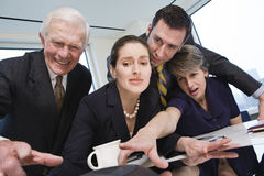 Four business people reaching for the conference c Stock Photos