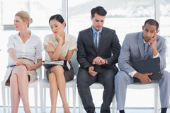 Four business people waiting for job interview Stock Images