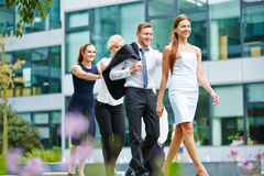 Four business people walking as a team Stock Image