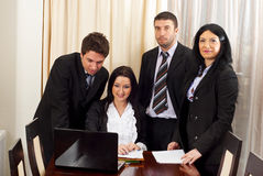 Four business people working Stock Photography
