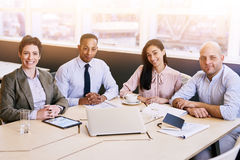 Four business professionals looking at the camera during a meeting Royalty Free Stock Image