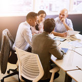 Four business professionals in a meeting indoors stock photo
