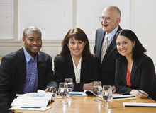 Four business workers smiling Royalty Free Stock Image