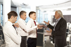 Four businessman are trying to come to an agreement Royalty Free Stock Photography