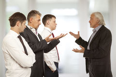 Four businessman are trying to come to an agreement. Business conflict concept. Four businessman are trying to come to an agreement Stock Image