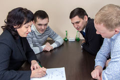 Four businessmans sitting in office Royalty Free Stock Images