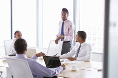 Four Businessmen Having Meeting Around Boardroom Table Royalty Free Stock Photography