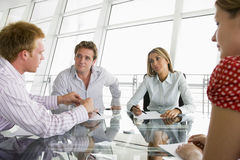 Four businesspeople in a boardroom Stock Photography