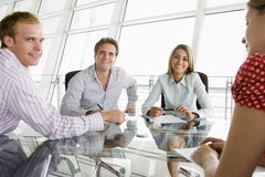 Four businesspeople in a boardroom Royalty Free Stock Photos