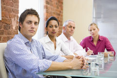 Four businesspeople in boardroom Royalty Free Stock Image