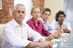 Four businesspeople in boardroom Stock Image